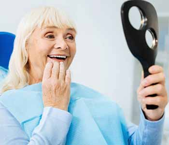 Are dentures worth it? Learn about affordable solutions from Dr. Ann Kelley at Kingsgate Dental in Kirkland, WA!
