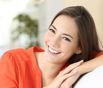 Young lady smilling with showing her brighter teeth